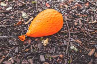 ground orange balloon deflated