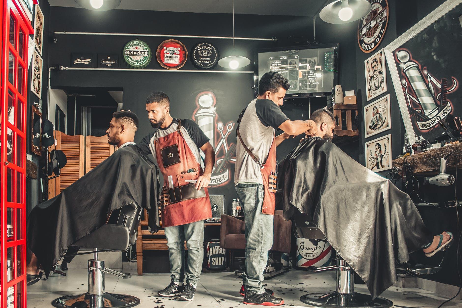 men having their haircut