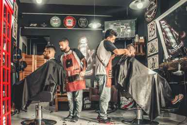 men having their haircut